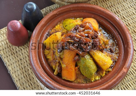 Couscous dish of chicken and vegetables, sweet sauce with raisins and onions in a restaurant in Marrakesh , Morocco