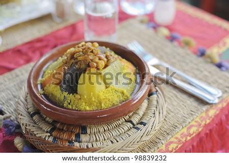 Couscous served on a brown plate in a Marrakesh restaurant - stock photo