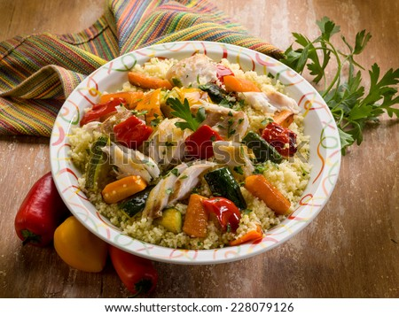 couscous with fish and vegetables - stock photo
