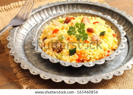 Couscous with lamb, vegetables and raisins - stock photo