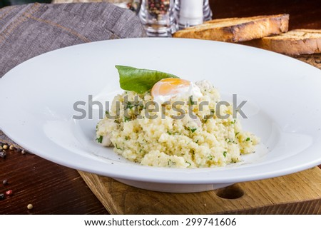 Couscous with poached egg and turkey