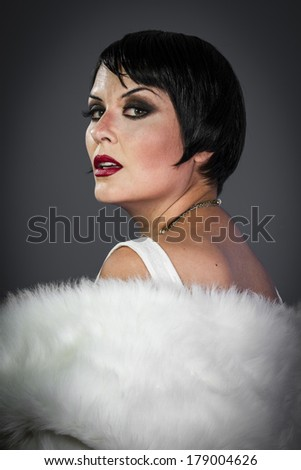 Couture, Retro posing lady,  flapper dress, Girl dreaming beautiful young woman from roaring 20s looking at camera.  vintage twenties - stock photo