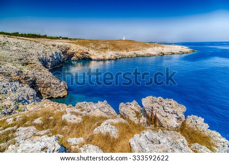 cove on the rocky beach of the Tower of the Serpent near Otranto in Puglia, Italy - stock photo