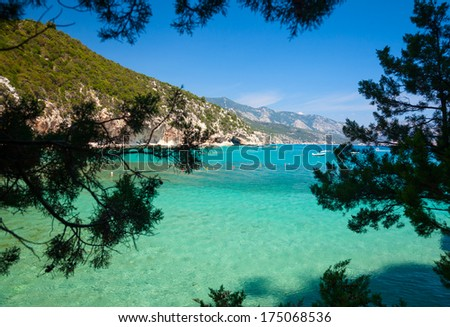 Cove with clear turquoise water in Sardinia - stock photo