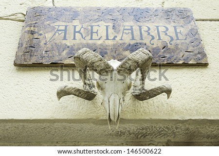 Coven of witchcraft with billy goat skeleton at the entrance, sorcery, and event - stock photo