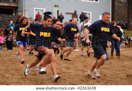 "COVENTRY, CT - DECEMBER 5: Volunteers from the Hartford Police Department brave icy waters to raise money for the Special Olympics at a ""Penguin Plunge"" event on December 5, 2009 in Coventry, CT."