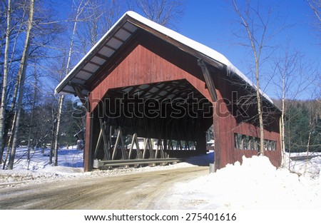 Covered bridge along Brook Road in Stowe, Vermont during the winter - stock photo
