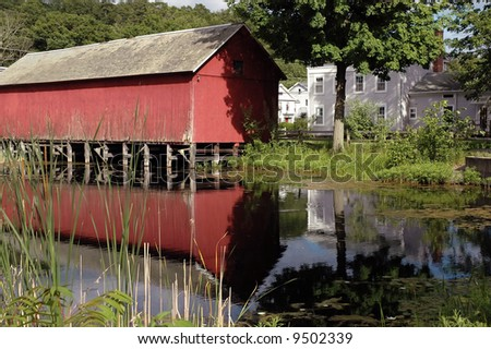 covered bridge and water - stock photo