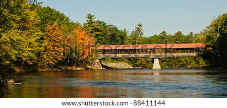Covered Bridge in fall foliage, New Hampshire - stock photo