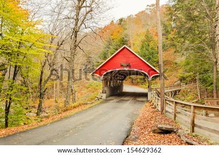 Covered Bridge in Franconia in Autumn, New Hampshire - stock photo
