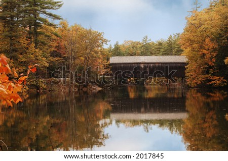 covered bridge in Maine during fall colors - stock photo