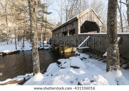 Covered bridge on winter day in Devil's Hopyard State Park
