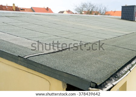 covered flat roof with roofing felt / Roof - stock photo