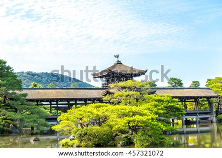 Covered japanese bridge in the garden of Heian Shrine in Kyoto - stock photo