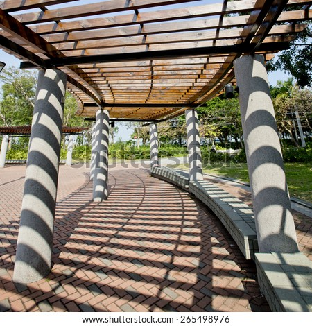 Covered walkway in the park on a Sunny Day - stock photo