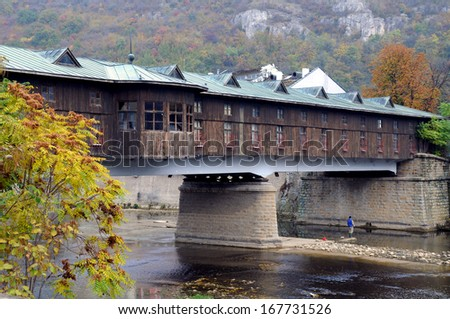 Covered wooden bridge in the town of Lovech in Bulgaria over the Osam river - stock photo