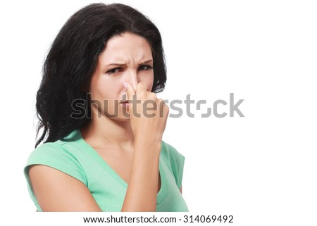 Covering her nose after a bad smell