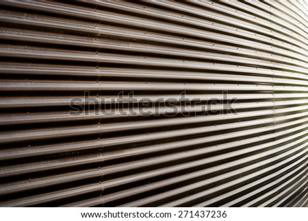 Covering of corrugated iron wall in diminishing perspective texture background