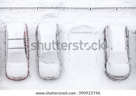 Covering with snow line of vehicles with vacant parking place, snowfall at winter