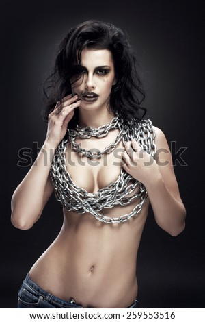 coveted girl with a chain on his chest - stock photo