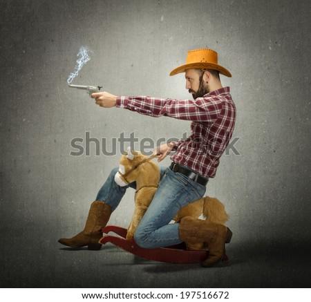 cow boy ride a fake horse - stock photo