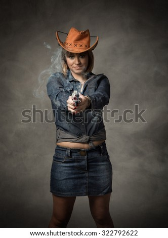 cow girl with gun, cloudy portrait - stock photo