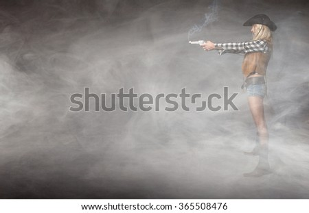 cow girl with gun on hand, lateral profile - stock photo