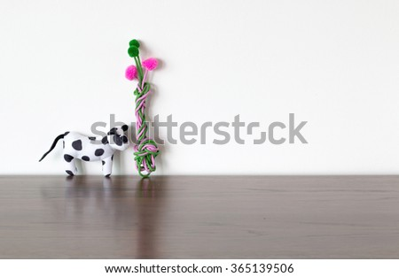 cow toys and colorful tree - stock photo