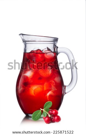 Cowberry juice in pitcher - stock photo