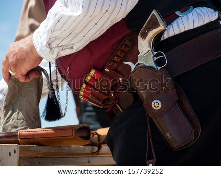 Cowboy Action Shooting Club.  The firearms used are based on those which existed in the 19th century American West, i.e. lever action rifle, single action revolver, and shotgun. - stock photo