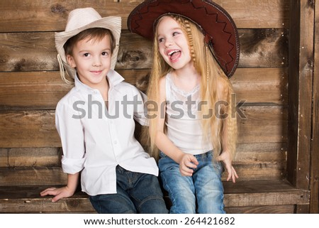 Cowboy and cowgirl portrait kids