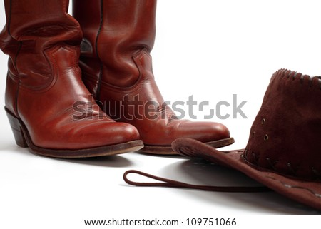 Cowboy boots and hat, isolated - stock photo
