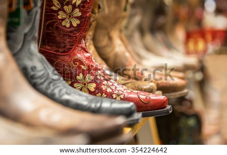 Cowboy boots in a store - stock photo