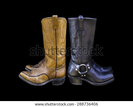 cowboy boots isolated on a black background. - stock photo