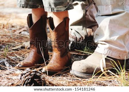Cowboy boots kid work boots man - stock photo