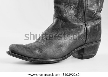 Cowboy boots with room for your type in black and white.