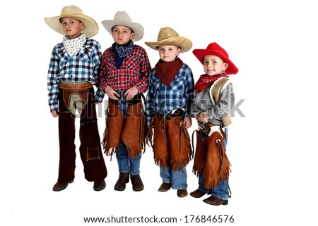 cowboy brothers standing wearing hats and chaps - stock photo