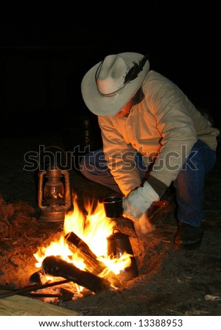 cowboy campfire before dawn - stock photo