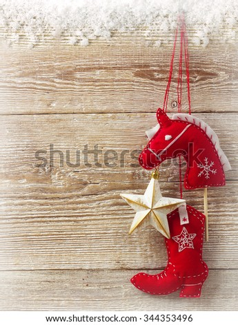 Cowboy christmas handmade toys on wood texture background for text - stock photo