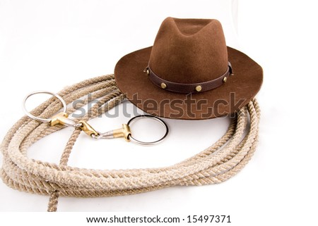 Cowboy gear - western riding equipment, hat and rope - stock photo