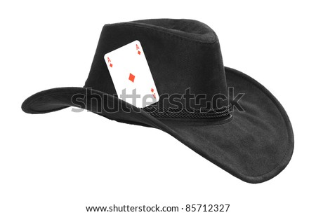 Cowboy hat with ace. Metaphor of successful man. - stock photo
