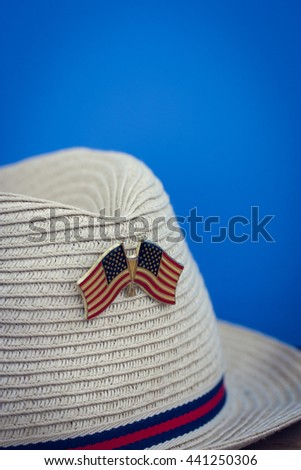 cowboy hat with flags of America, macro , vintage, independence day, blue background, copy space for text