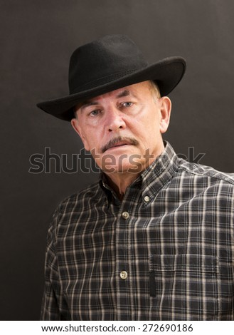 Cowboy in black hat - stock photo