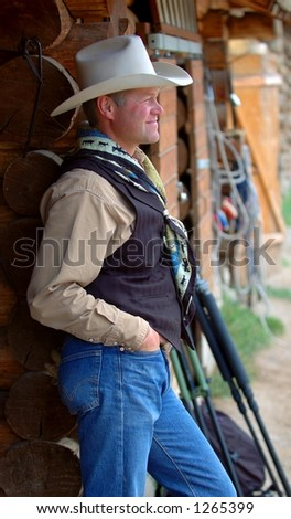 Cowboy Leaning Against Building - Side - stock photo