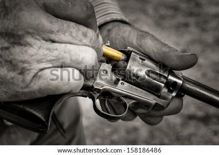 Cowboy Loading a Gun - stock photo