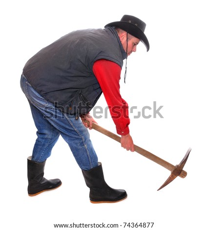 Cowboy with pick axe on a white background.  Under construction metaphor. - stock photo