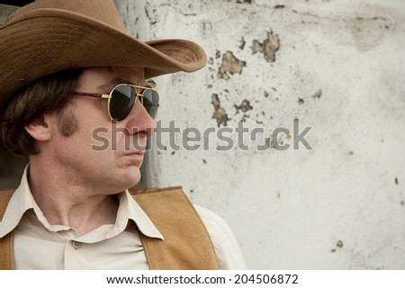 Cowboy With Sunglasses - stock photo