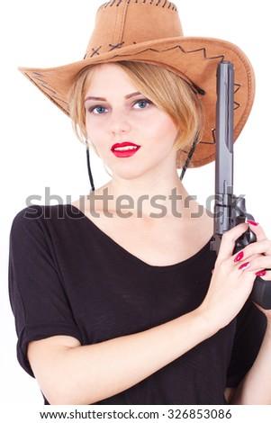 Cowboy woman concept holding a big gun  - stock photo