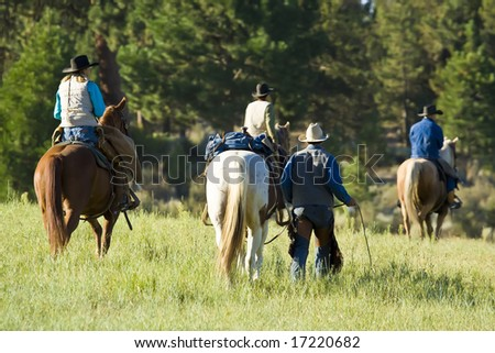 Cowboys and Cowgirls with their in Morning Light - stock photo
