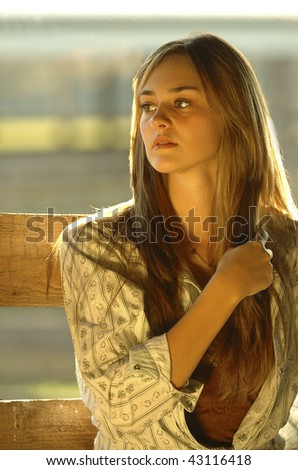 cowgirl at sunset - stock photo